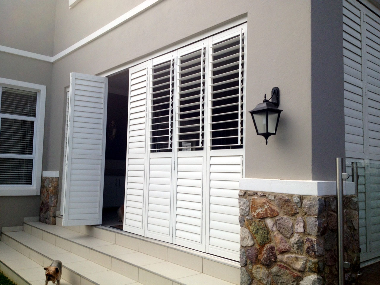 Security shutters keep your home safe for Interior window security shutters